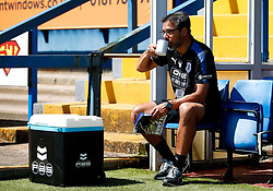 Huddersfield Town manager David Wagner takes a drink whilst reading the matchday programme in the dugout - Mandatory by-line: Matt McNulty/JMP - 16/07/2017 - FOOTBALL - Gigg Lane - Bury, England - Bury v Huddersfield Town - Pre-season friendly