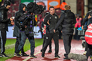 Heart of Midlothian manager Daniel Stendel looks dejected as he shakes hands with Manager of Celtic FC, Neil Lennon after the final whistle of the Ladbrokes Scottish Premiership match between Heart of Midlothian FC and Celtic FC at Tynecastle Park, Edinburgh, Scotland on 18 December 2019.