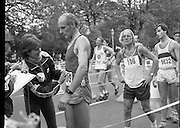Finish of Dublin City Marathon .25/10/1982  Radio 2, Dublin City Marathon..1982.25.10.1982.10.25.1982.25th October 1982..The Radio 2 sponsored Dublin City Marathon finish at St Stephens Green Dublin..The overall winners were:Men, Gerry Kiernan,Listowel, Kerry. Women, Debbie Mueller,U.S.A. and the first wheelchair competitor Michael O'Rourke.At the end of a hard day numbers are checked for the awarding of finishers medals.