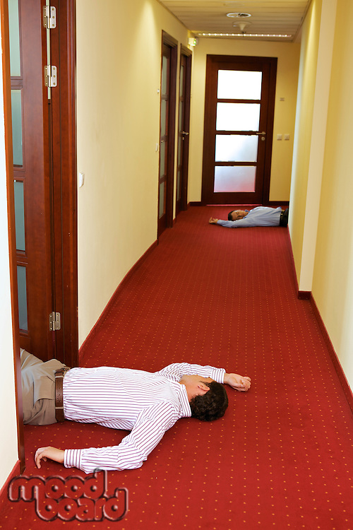 Two businessman lying down in office