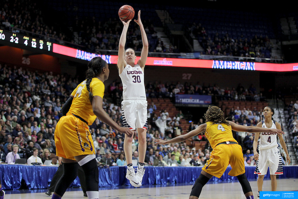 Breanna Stewart, (center), UConn, takes a jump shot watched by L'Tiana Taylor, (left) and DeVaughn Gray, East Carolina,  during the UConn Huskies Vs East Carolina Pirates Quarter Final match at the  2016 American Athletic Conference Championships. Mohegan Sun Arena, Uncasville, Connecticut, USA. 5th March 2016. Photo Tim Clayton