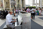 Chobani founder, president and CEO Hamdi Ulukaya sits at a piano designed by Chobani employees, one of the 88 Sing for Hope Pianos, supported by Chobani, Inc., at Lincoln Center, Sunday, June 16, 2013, in New York. The event celebrates the conclusion of the Sing for Hope Pianos project, a two-week public art installation around the five boroughs of New York.  (Photo by Diane Bondareff/Invision for Sing for Hope/AP Images)