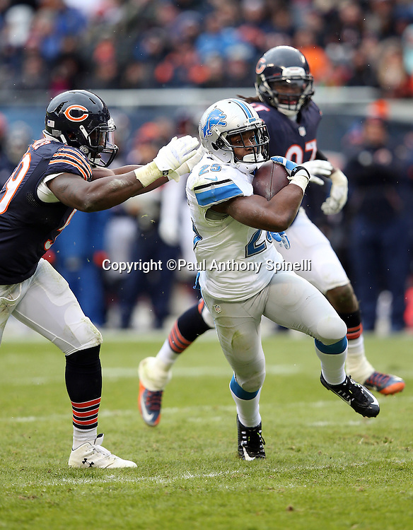 Detroit Lions running back Theo Riddick (25) is chased by Chicago Bears inside linebacker Christian Jones (59) as he catches an 18 yard pass for first and goal from the Chicago Bears 4 yard line in the fourth quarter during the NFL week 17 regular season football game against the Chicago Bears on Sunday, Jan. 3, 2016 in Chicago. The Lions won the game 24-20. (©Paul Anthony Spinelli)