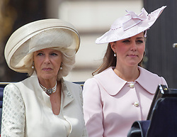 LONDON - UK - 15 JUNE 2013: Kate, the Duchess of Cambridge with the Duchess of Cornwall.<br /> Members of the British Royal Family join HM Queen Elizabeth for the annual Trooping The Colour Ceremony to mark the Queen's Official Birthday. The Queen and members of the family travelled by carriage to Horseguards for the ceremonial parade before joining her on the balcony of Buckingham Palace.<br /> The Duke of Edinburgh who normally accompanies the Queen was absent as he is still in hospital recovering from an operation.<br /> Photograph by Ian Jones.