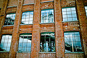 Reflection of the Manhattan Bridge in the windows of a brownstone building in DUMBO, Brooklyn, New York, 2008.