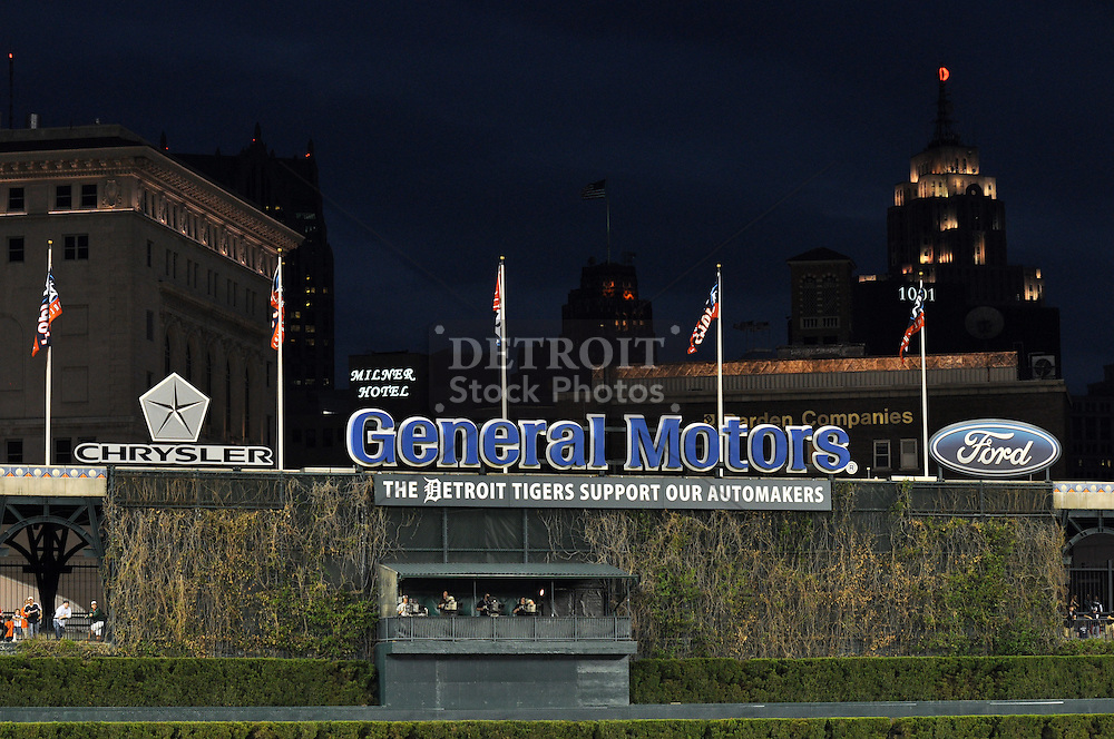 Comerica Park and the Detroit Tigers pays tribute to Detroit's automakers. All logos of the Big Three, Chrysler, General Motors and Ford are displayed in center field.