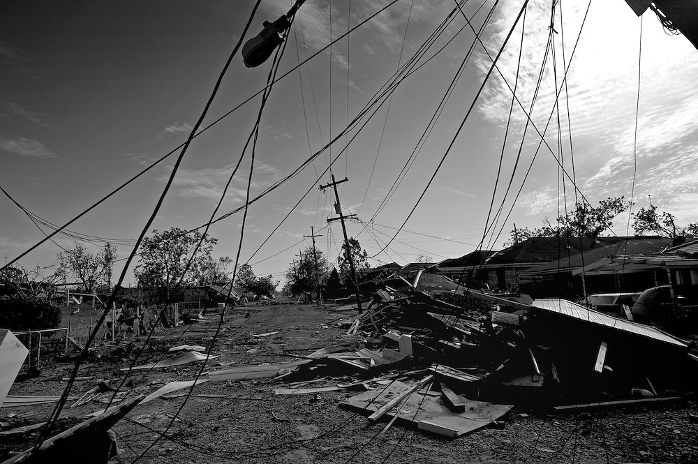 Power lines and destruction line the once lively streets of the lower ninth ward over a month after hurricane katrina made lanfall 8 October 2005 New Orleans Louisiana.  (photo by Darren Hauck)