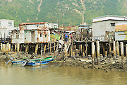HONG KONG, CHINA - SEPTEMBER 15, 2012: Exterior of the Tai O fishermen village with stilt houses and motorboats in Hong Kong, China. Tai O is a famous tourist destination in Hong Kong.