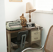 Desk in the small bedroom  in the rectory home of martyred Archbishop Oscar Romero. Romero's home has been made into a museum of the life and death of the Salvadoran priest.El Salvador prepares for the beatification ceremony and mass announcing the beatification of Archbishop Oscar Romero. The Archbishop was slain at the alter of his Church of the Divine Providence by a right wing gunman in 1980. Oscar Arnulfo Romero y Galdamez became the fourth Archbishop of San Salvador, succeeding Luis Chavez, and spoke out against poverty, social injustice, assassinations and torture. Romero was assassinated while offering Mass on March 24, 1980.