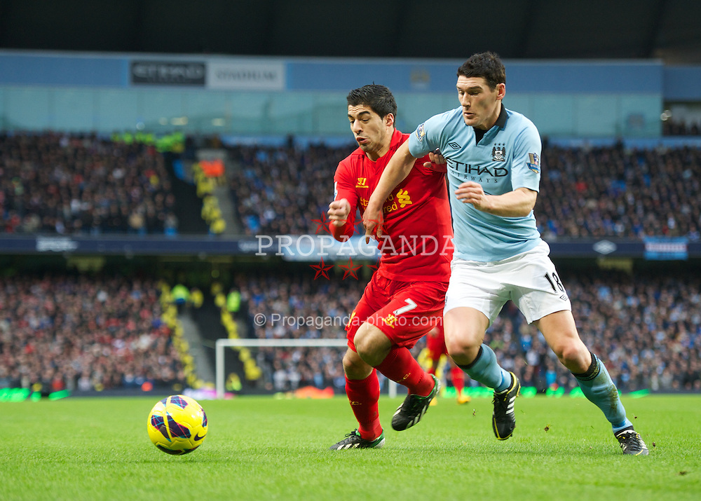 MANCHESTER, ENGLAND - Sunday, February 3, 2013: Liverpool's Luis Alberto Suarez Diaz in action against Manchester City's Gareth Barry during the Premiership match at the City of Manchester Stadium. (Pic by David Rawcliffe/Propaganda)