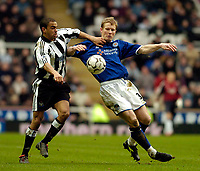 Photo. Jed Wee.<br /> Newcastle United v Leicester City, FA Barclaycard Premiership, St James' Park, Newcastle. 07/02/2004.<br /> Newcastle's Kieron Dyer (L) shrugs aside the attentions of Leicester's Ben Thatcher.