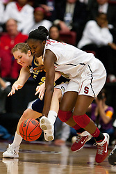 March 19, 2011; Stanford, CA, USA; Stanford Cardinal forward Chiney Ogwumike (13) and UC Davis Aggies forward/center Lauren Juric (23) fight for a loose ball during the first half of the first round of the 2011 NCAA women's basketball tournament at Maples Pavilion.