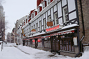 Snow covered downtown street during Winter Carnival. Quebec, Canada.