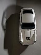 Image of a white 1968 Porsche 911S raced by Davey Jordan with Vasek Polak, Santa Cruz, California, America west coast