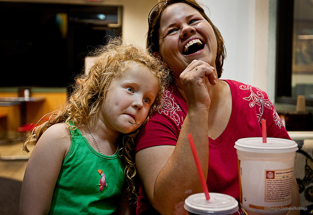 "Jana laughs at the mysterious smudge on her daughter's face while making good on her promise to take her to Burger King if she won the crown, on Saturday night in Nelsonville. ""We won Sissy, we won!"" Jana said to her daughter."
