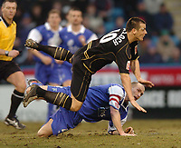 Picture: Henry Browne.<br /> Date: 26/02/2005.<br /> Gillingham v Wigan Athletic Coca Cola Championship.<br /> Lee McCulloch of Wigan is sent flying by Paul Smith of Gills.