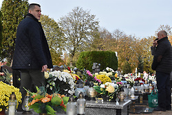 November 1, 2018 - Scinawa, Poland - Polish people lays candles as they visit mass graves of their loved ones. All Saints' Day in Poland is dedicated to prayer and paying tribute to the deceased by visiting their graves...Poland - All Saints' Day in Poland - November 1st Polish people visit mass graves of their loved ones. All Saints' Day in Poland is a holiday for everybody except of transportation and emergency services. (Credit Image: © Piotr Twardysko/ZUMA Wire)
