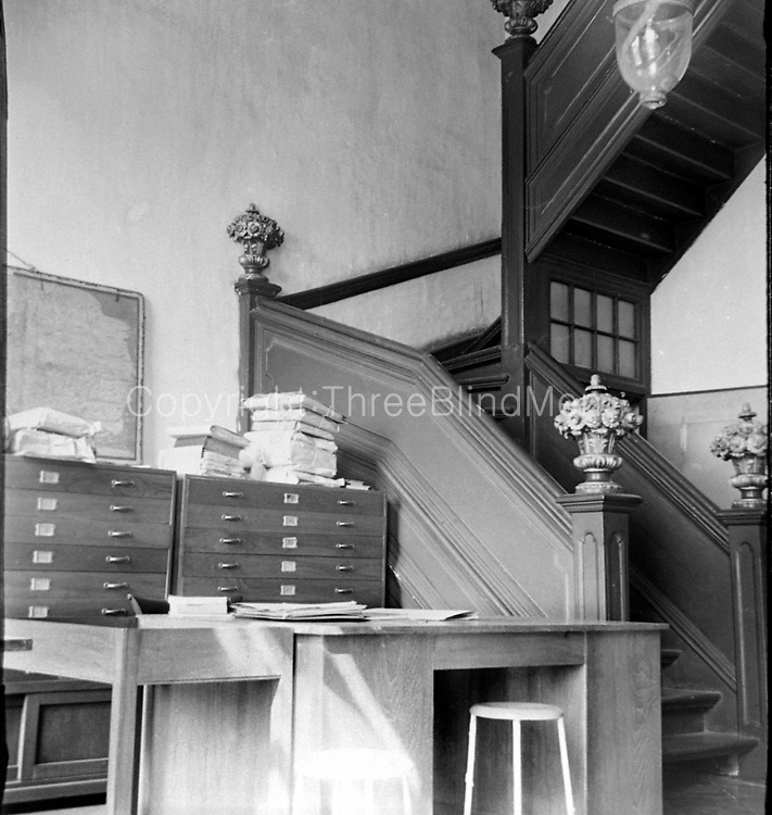 Desk, stool and staircase.