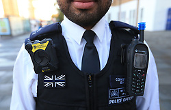 Pc Richard Gayle wears a Body Worn Video (BWV) camera outside Lewisham Police Station, London, as large scale deployment of the cameras to over 22,000 Metropolitan Police officers starts.