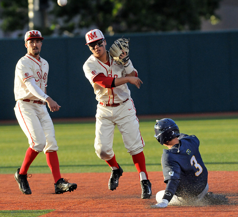 jt051817g/ sports/jim thompson/  UNM's shortstop #3 Hayden Schilling  looks on as teammate #5 Justin Water makes the tag on the bag to get out the runner  Nevada's #3 Justin Bridgman on the double play in their game Thursday night. Thursday May. 18, 2017. (Jim Thompson/Albuquerque Journal)