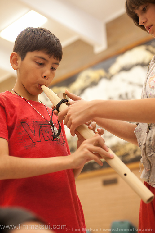 Youth participate in Indian Education at a Native American flute carving workshop by Tom Stewart of Stellar Flutes.