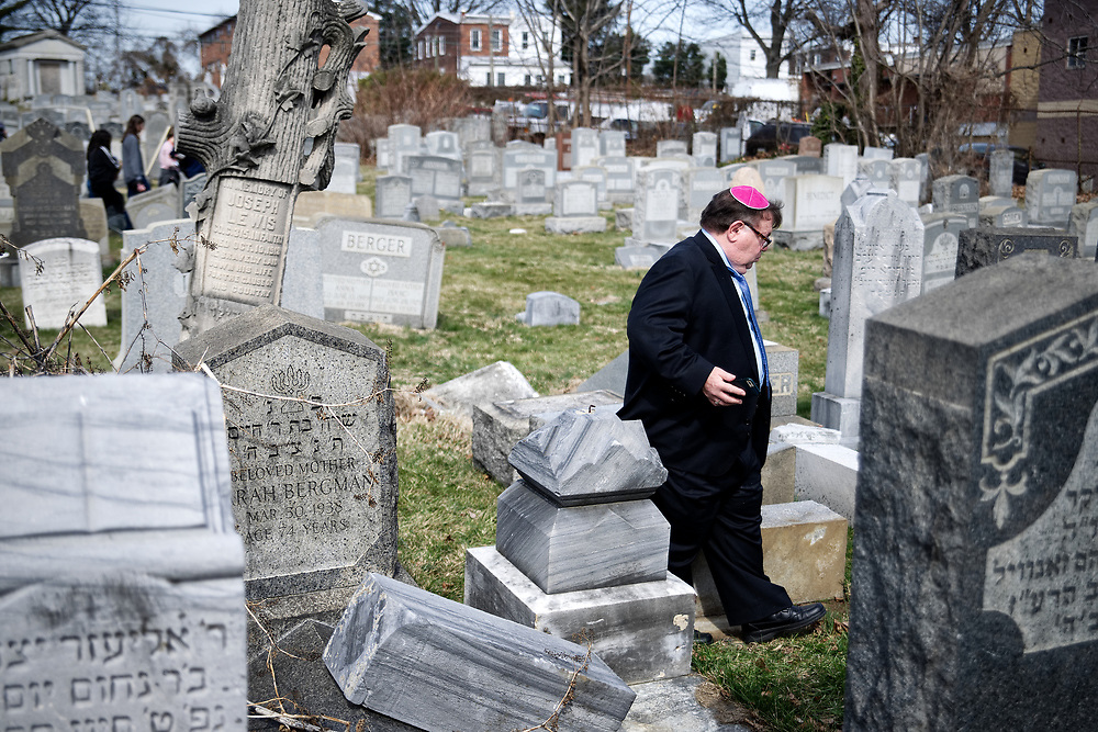 Shelly Farber, of Broomall, PA, searches for the resting place of his relatives at Mt Carmel Cemetery in Philadelphia, PA, on Feb. 28, 2017. Volunteer effort is on its way to clean up the Jewish cemetery after hundreds of graves got vandalized over the weekend.