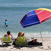 Beach goers enjoy the sun in South Florida.<br /> Photography by Jose More
