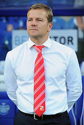 Swindon Town Manager, Mark Cooper   - Photo mandatory by-line: Seb Daly/JMP - Tel: Mobile: 07966 386802 27/08/2013 - SPORT - FOOTBALL - Loftus Road - London - Queens Park Rangers V Swindon Town -  Capital One Cup - Round 2
