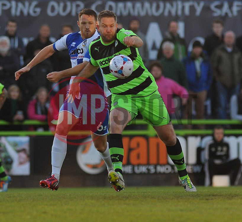 Bristol Rovers' Tom Parkes and Forest Green Rovers's Jonathan Parkin battle for the ball. - Photo mandatory by-line: Nizaam Jones/JMP - Mobile: 07966 386802 - 29/04/2015 - SPORT - Football - Nailsworth - The New Lawn - Forest Green Rovers v Bristol Rovers - Vanarama Football Conference