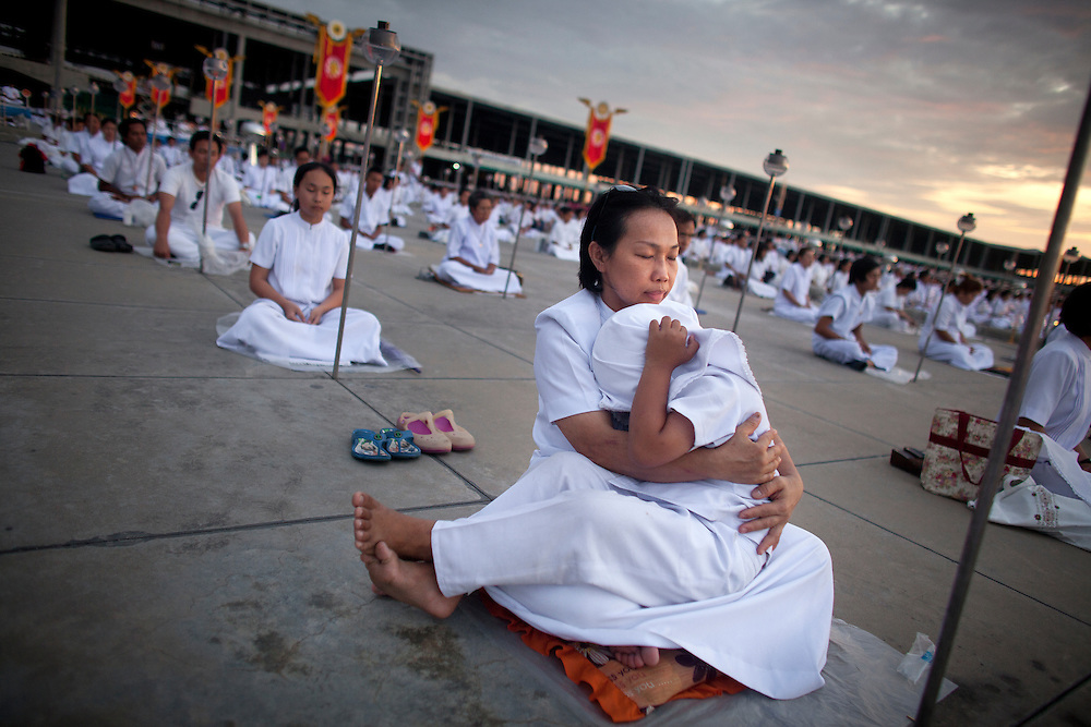 Devotees of the Dhammakaya Buddhist movement founded in Thailand is seen during Makha Bucha day at Wat Phra Dhammakaya  on the outskirts of Bangkok, Thailand Wednesday, March 7, 2012.