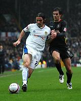Photo: Paul Greenwood/Sportsbeat Images.<br /> Leeds United v Huddersfield Town. Coca Cola League 1. 08/12/2007.<br /> Huddersfield's Danny Schofield (R) goes shoulder to shoulder with Leeds David Prutton