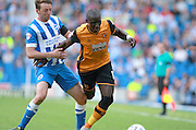 Hull City midfielder Mohammed Diame shrugs off a challenge from Brighton central midfielder Dale Stephens during the Sky Bet Championship match between Brighton and Hove Albion and Hull City at the American Express Community Stadium, Brighton and Hove, England on 12 September 2015. Photo by Bennett Dean.