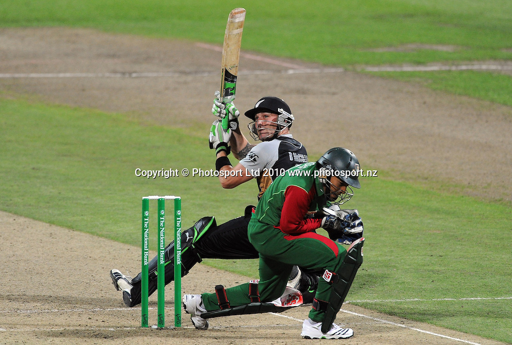 Brendon McCullum batting during his innings of 56 not out as Bangladesh wicketkeeper Mushfiqur Rahimtakes evasive action.<br />