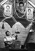 "Morshed ""master"" (beating the drum and reciting poetry) in a Zurkhaneh (house of strength) during a session of Varzesh-e Pahlavani (Irananian national sport), Yazd, Iran"