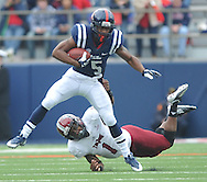 Mississippi running back I'Tavius Mathers (5) is tackled by Troy safety Camren Hudson  (1) at Vaught-Hemingway Stadium in Oxford, Miss. on Saturday, November 16, 2013. (AP Photo/Oxford Eagle, Bruce Newman)