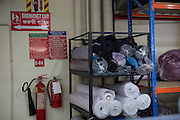 Fire extinguishers and emergency exit sign inside Epyllion Group garment factory in Bangladesh.