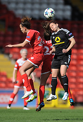 Bristol Academy's Gabbie Simmons-Bird challenges for the ariel ball with FFC Frankfurt's Peggy Kuznik - Photo mandatory by-line: Dougie Allward/JMP - Mobile: 07966 386802 - 21/03/2015 - SPORT - Football - Bristol - Ashton Gate Stadium - Bristol Academy v FFC Frankfurt - UEFA Women's Champions League - Quarter Final - First Leg