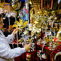 Valentina an artisan at Peter Pan shows two of her masks. Artisans, masks and costumes makers are getting ready ahead of Venice Carnival 2013