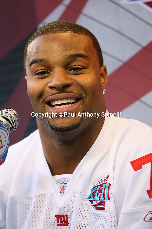 GLENDALE, AZ - JANUARY 29: Defensive end Osi Umenyiora #72 of the New York Giants smiles as he speaks to the media at the Giants Super Bowl XLII Media Day at University of Phoenix Stadium on January 29, 2008 in Glendale, Arizona.©Paul Anthony Spinelli *** Local Caption *** Osi Umenyiora