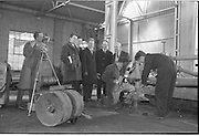 21/02/1963.02/21/1963.21 February 1963.Teachers tour Bord na Mona workshops. Vocational school teachers, whose past pupils include Bord na Mona apprntices, were guests at three of the Board's workshops., to study the organisation of the workshops and watch apprntices on the job. Watching fitter Stan Mulrin and 2nd year apprentice Seamus Kilmurray works at Derrygreenagh milled-peat works, Co. Offaly, (l-r) were teachers M. Hillery (Portarlington V.S.), S. Crowley (Tullomore V.S.), A. Egan (Portarlington V.S.), B. Clancy (Lanesboro' V.S.) and John Murphy, Workshop Foreman. Cameraman unknown.