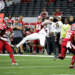 Aug 31, 2019; New Orleans, LA, USA; Mississippi State Bulldogs wide receiver Isaiah Zuber (12) catches a pass between Louisiana-Lafayette Ragin Cajuns safety Jaden Henderson (29) and defensive back Kam Pedescleaux (36) during the second half at the Mercedes-Benz Stadium. Mandatory Credit: Derick E. Hingle-USA TODAY Sports