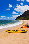 Sea kayaks on Miloli'i Beach, Na Pali Coast, Island of Kauai, Hawaii