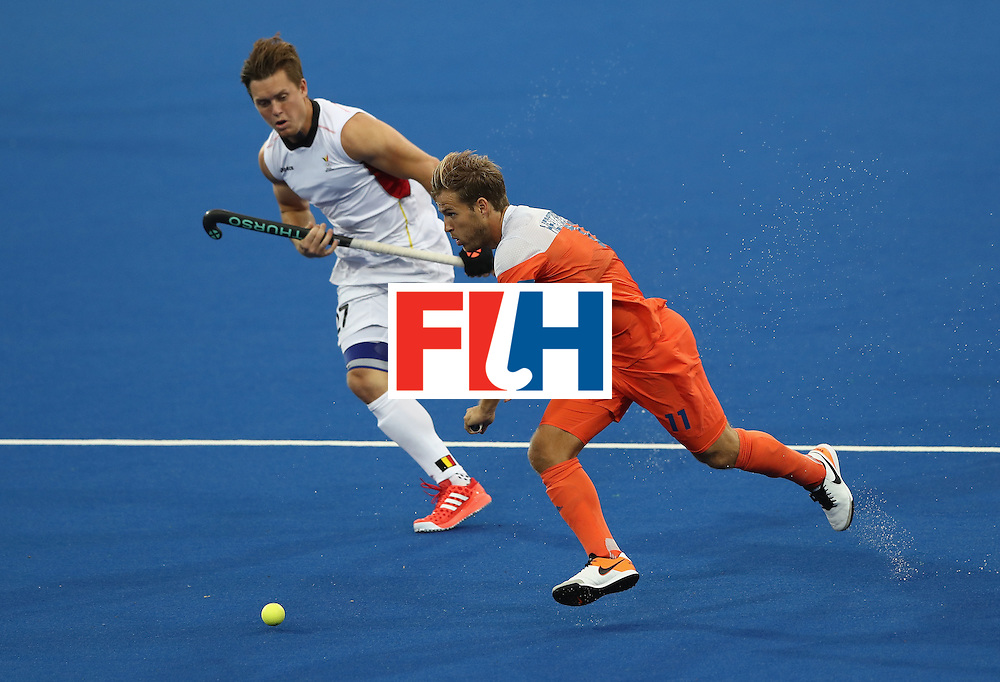 RIO DE JANEIRO, BRAZIL - AUGUST 16:  Jeroen Hertzberger of the Netherlands moves away from Tom Boon during the Men's semi final hockey match between Belgium and the Netherlands on Day 11 of the Rio 2016 Olympic Games held at the Olympic Hockey Centre on August 16, 2016 in Rio de Janeiro, Brazil.  (Photo by David Rogers/Getty Images)