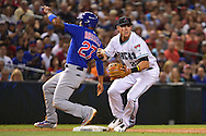 PHOENIX, ARIZONA - APRIL 08:  Jake Lamb #22 of the Arizona Diamondbacks records a force out at third base on Addison Russell #27 of the Chicago Cubs in the third inning at Chase Field on April 8, 2016 in Phoenix, Arizona.  (Photo by Jennifer Stewart/Getty Images)