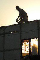 China, Beijing, Ping Fang Xiang, 2008. Workers demolish their temporary homes now that the Ding Fu Jia Yuan development next to Ping Fang Xiang village is complete..