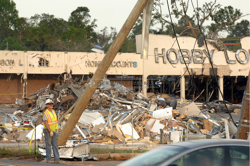 A member of a cleanup crew stands near a strip mall in Tuscaloosa, Alabama, Saturday, April 30, 2011.  The second worst outbreak of tornadoes in US history passed through the southeastern Untited States on April 27, 2011.  The death toll in Alabama is the highest of any state.Tuscaloosa, Alabama, Saturday, April 30, 2011. Tornado Damage in Alabama 2011