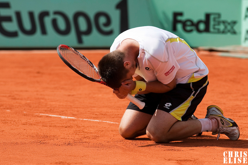 5 June 2009: Robin Soderling of Sweden falls to his knees as he celebrates victory during the Men's Singles Semi Final match on day thirteen of the French Open at Roland Garros in Paris, France.