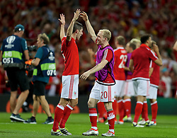 TOULOUSE, FRANCE - Monday, June 20, 2016: Wales' Ben Davies and Jonathan Williams celebrate the 3-0 victory over Russia and reaching the knock-out stage during the final Group B UEFA Euro 2016 Championship match at Stadium de Toulouse. (Pic by David Rawcliffe/Propaganda)