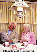 Active Aging, Senior Citizens, Retired, Activities, Elderly Happily Retired at Home, Relaxed in Home, Breakfast, Newspaper, Sharing