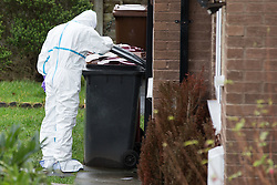 © Licensed to London News Pictures . 11/02/2014 . Blackburn , UK . A forensic scenes of crime investigator at the scene . Police and forensic examiners on Emily Street in Blackburn at the scene where an eleven month old baby girl was mauled to death late last night (10th February 2014) . Photo credit : Joel Goodman/LNP